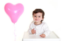 Baby with heart shaped balloon Royalty Free Stock Photos