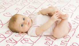 Baby on hearts Royalty Free Stock Photography