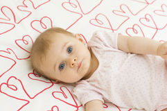 Baby on hearts Royalty Free Stock Photo