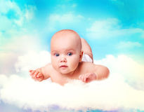 Baby in heaven.Infant over sky. Baby over clouds in sky.Infant girl in heaven.Softness skin care concept background empty space.Newborn  staff advertisement Royalty Free Stock Photography