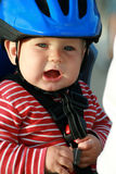 Baby in helmet - bicycle chair Stock Photos