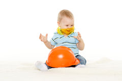 Baby with helmet and protective glasses. Royalty Free Stock Photo