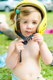 Baby girl with yellow helmet Royalty Free Stock Images