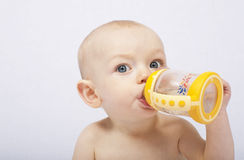 Baby with her baby bottle Royalty Free Stock Photo