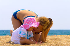 Baby with her mother on the beach Royalty Free Stock Image