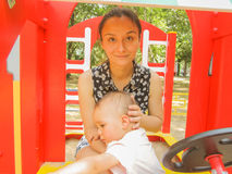 Baby and her mother are playing together on a playground. Photo took in Russia, Moscow, baby girl is 21 month Stock Photos