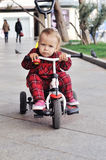 Baby on her  tricycle Royalty Free Stock Images