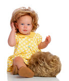 Baby And Her Wig. A baby adjusting her wig Stock Photography