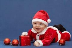 Baby in het kostuum van santa Stock Foto's