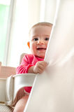 Baby hide curtains playful newborn smile Royalty Free Stock Images