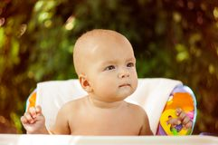 Baby in High Chair Royalty Free Stock Image