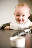 Baby in high chair ready to eat Royalty Free Stock Images