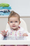 Baby in Highchair Stock Photography