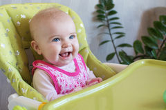 Baby in highchair Stock Image