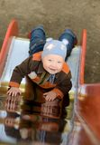 Baby on hillock. Smiling baby lie on hillock royalty free stock photography