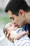 Baby and his father. Father holding sweet baby boy Royalty Free Stock Images