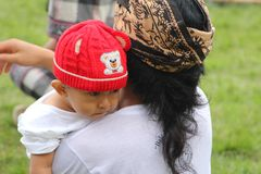 Baby with his father at feastday in Bali, Indonesia Stock Photography