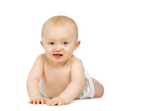 Baby on his front isolated on a white background Royalty Free Stock Photo