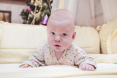 Baby in his leisure time. In bed Stock Image