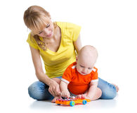 Baby and his mom play musical toys. Isolated on white stock photography