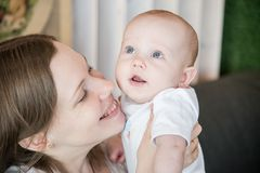 Baby with his mother Stock Images