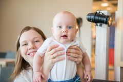Baby with his mother posing Stock Photos