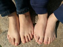 Baby and his mother`s feet Royalty Free Stock Photography