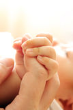 Baby hold mother finger Royalty Free Stock Photo