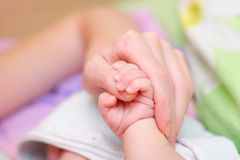 Baby hold mother finger on your hand Royalty Free Stock Photos