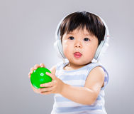 Baby hold plastic ball with headphone Stock Photography