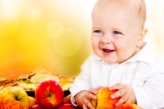 Baby holding apples Royalty Free Stock Images