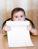 Baby holding a blank paper. Royalty Free Stock Photography