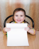Baby holding a blank paper. Royalty Free Stock Photos