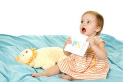 Baby holding a book royalty free stock photo