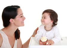 Baby holding cake Stock Photography