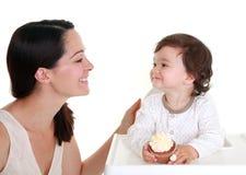 Baby holding cake stock photography