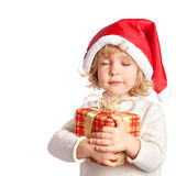 Baby holding Christmas gift Stock Photos