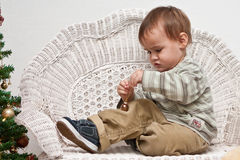 Baby holding Christmas ornament Royalty Free Stock Photo