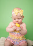 Baby holding an Easter Egg Stock Photos