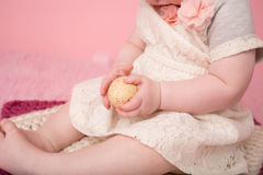 Baby holding an Easter Egg Stock Image