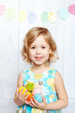 Baby holding Easter eggs. Happy little girl holding Easter eggs royalty free stock images