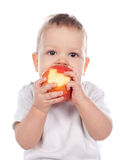 Baby holding and eating an apple isolated on white Royalty Free Stock Photo