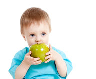 Baby holding and eating healthy food on white Royalty Free Stock Photos