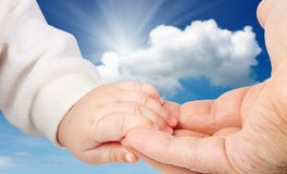 Baby holding father's hand Royalty Free Stock Images