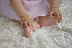 Baby Holding Feet Royalty Free Stock Photography