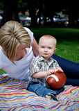 Baby Holding Football - vertical Royalty Free Stock Photography