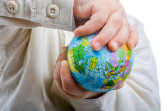 Baby holding a globe Stock Image
