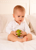 Baby holding a green apple Royalty Free Stock Image
