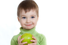 Baby holding green apple isolated on white Stock Photo