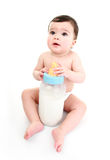 Baby holding large milk bottle Stock Photography